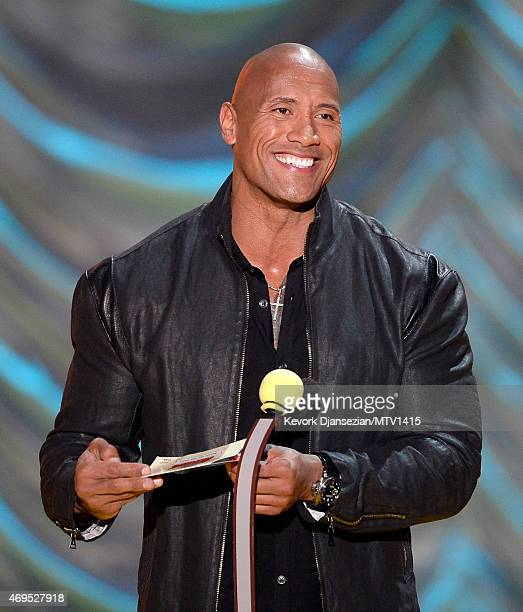 Actor Dwayne Johnson speaks onstage during The 2015 MTV Movie Awards at Nokia Theatre LA Live on April 12 2015 in Los Angeles California