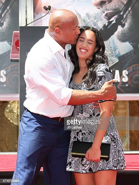 Actor Dwayne 'The Rock' Johnson and daughter Simone Alexandra Johnson attend the Dwayne 'The Rock' Johnson hand/footprint ceremony at the TCL Chinese...