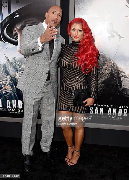 Actor Dwayne 'The Rock' Johnson and Eva Marie attend the 'San Andreas' Los Angeles Premiere at TCL Chinese Theatre IMAX on May 26 2015 in Hollywood...