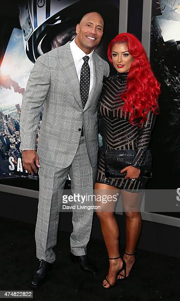 Actor Dwayne 'The Rock' Johnson and model Eva Marie attend the premiere of Warner Bros Pictures' 'San Andreas' at the TCL Chinese Theatre on May 26...