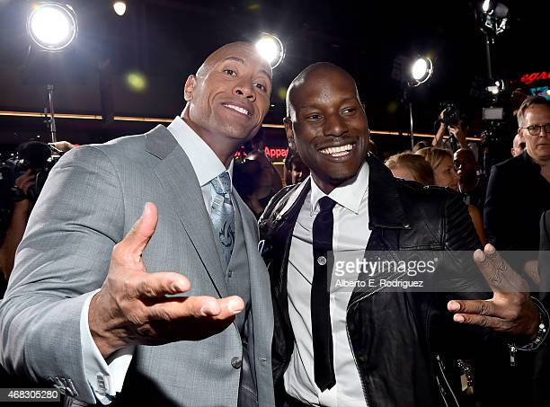 Actor Dwayne 'The Rock' Johnson and recording artist/actor Tyrese Gibson attend Universal Pictures' 'Furious 7' premiere at TCL Chinese Theatre on...
