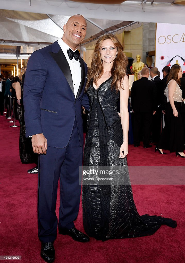 Actor Dwayne 'The Rock' Johnson (L) and singer Lauren Hashian attend the 87th Annual Academy Awards at Hollywood & Highland Center on February 22, 2015 in Hollywood, California.