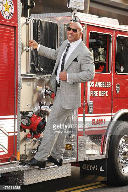 Actor Dwayne 'The Rock' Johnson arrives at the 'San Andreas' Los Angeles Premiere at TCL Chinese Theatre IMAX on May 26 2015 in Hollywood California