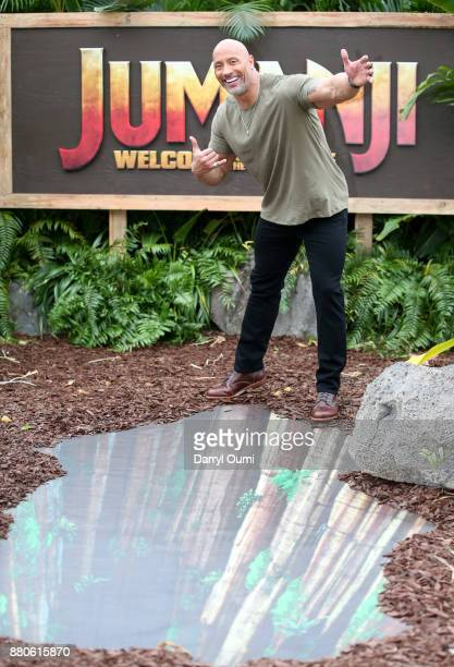 Actor Dwayne 'The Rock' Johnson attends a photocall for Columbia Pictures' Jumanji Welcome To The Jungle at the Four Seasons Resort Oahu at Ko Olina...
