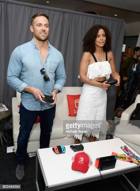 Actor Dylan Bruce and actress Parisa FitzHenley from the television series 'Midnight Texas' stopped by Nintendo at the TV Insider Lounge to check out...