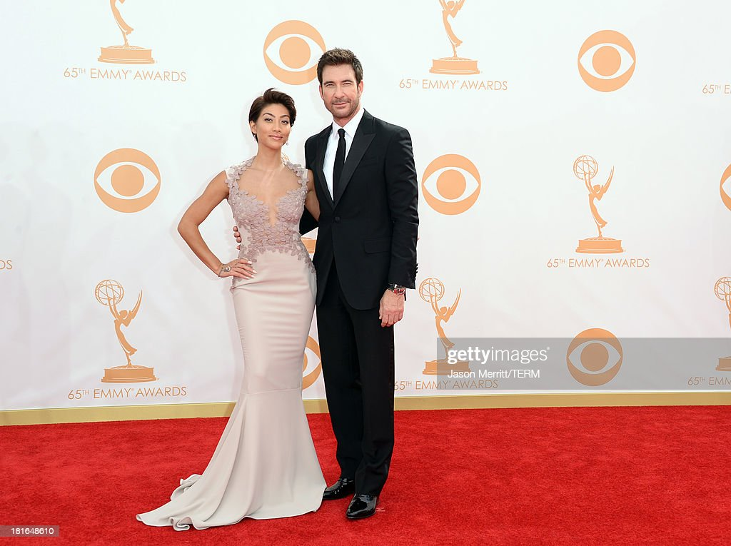 Actor Dylan McDermott (R) and Shasi Wells arrive at the 65th Annual Primetime Emmy Awards held at Nokia Theatre L.A. Live on September 22, 2013 in Los Angeles, California.