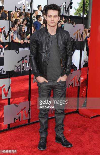 Actor Dylan O'Brien arrives at the 2014 MTV Movie Awards at Nokia Theatre LA Live on April 13 2014 in Los Angeles California