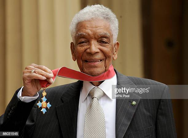 Actor Earl Cameron poses outside Buckingham Palace with his CBE presented by the Prince of Wales on May 28 2009 in London England