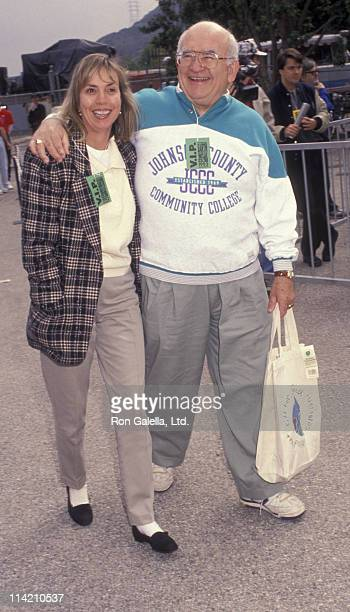 Actor Ed Asner and Cindy Cilmore attend Earthwalk Benefit on March 28 1992 at Universal Studios in Universal City California