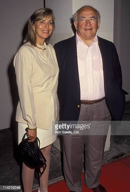 Actor Ed Asner and Cindy Gilmore attend the premiere of Bob Roberts on September 1 1992 at the Writer's Guild Theater in Beverly Hills California