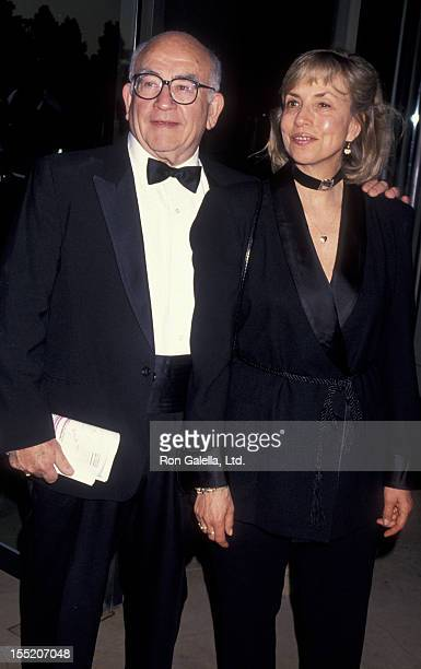 Actor Ed Asner and Cindy Gilmore attends 46th Annual Writer's Guild of America Awards on March 13 1994 at the Beverly Hilton Hotel in Beverly Hills...