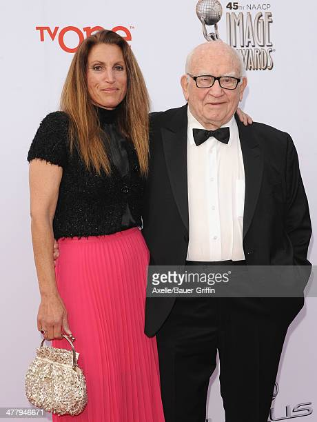Actor Ed Asner and daughter Liza Asner arrive at the 45th NAACP Image Awards at Pasadena Civic Auditorium on February 22 2014 in Pasadena California