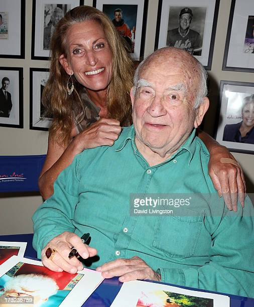 Actor Ed Asner and daughter Liza Asner attend a fan meet and greet at In Person Inc on July 10 2013 in Hollywood California