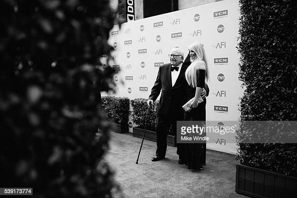 Actor Ed Asner and model Yvette Rachelle arrive at American Film Institute's 44th Life Achievement Award Gala Tribute to John Williams at Dolby...