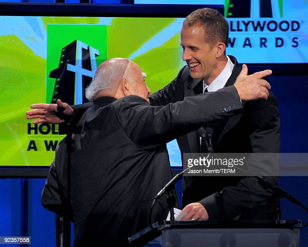 Actor Ed Asner presents the Animation Award to Pete Docter onstage during the 13th annual Hollywood Awards Gala Ceremony held at The Beverly Hilton...