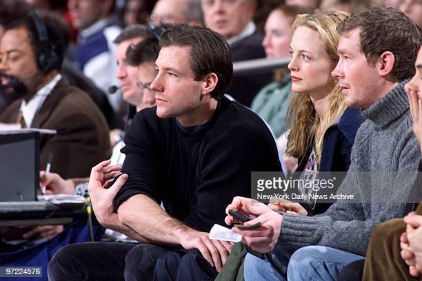 Actor Ed Burns and actress Heather Graham watch the New York Knicks take on the Washington Wizards at Madison Square Garden