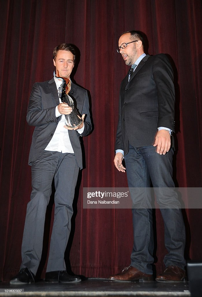 Actor Ed Norton holds his Golden Space Needle Award for excellence in acting with Carl Spence at Egyptian Theater, Seattle on June 4, 2010 in Seattle, Washington.