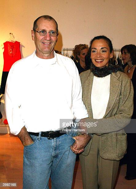 Actor Ed O''Neill and wife Cathy Rusoff poses at the opening party of the Nanette Lepore boutique on Robertson Blvd on October 14 2003 in Los Angeles