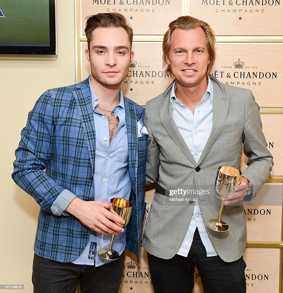 Actor Ed Westwick (L) and Moet & Chandon USA Vice President Ludovic du Plessis visit the Moet & Chandon Suite at the 2012 US Open at the USTA Billie Jean King National Tennis Center on September 10, 2012 in the Flushing neighborhood of the Queens borough of New York City.