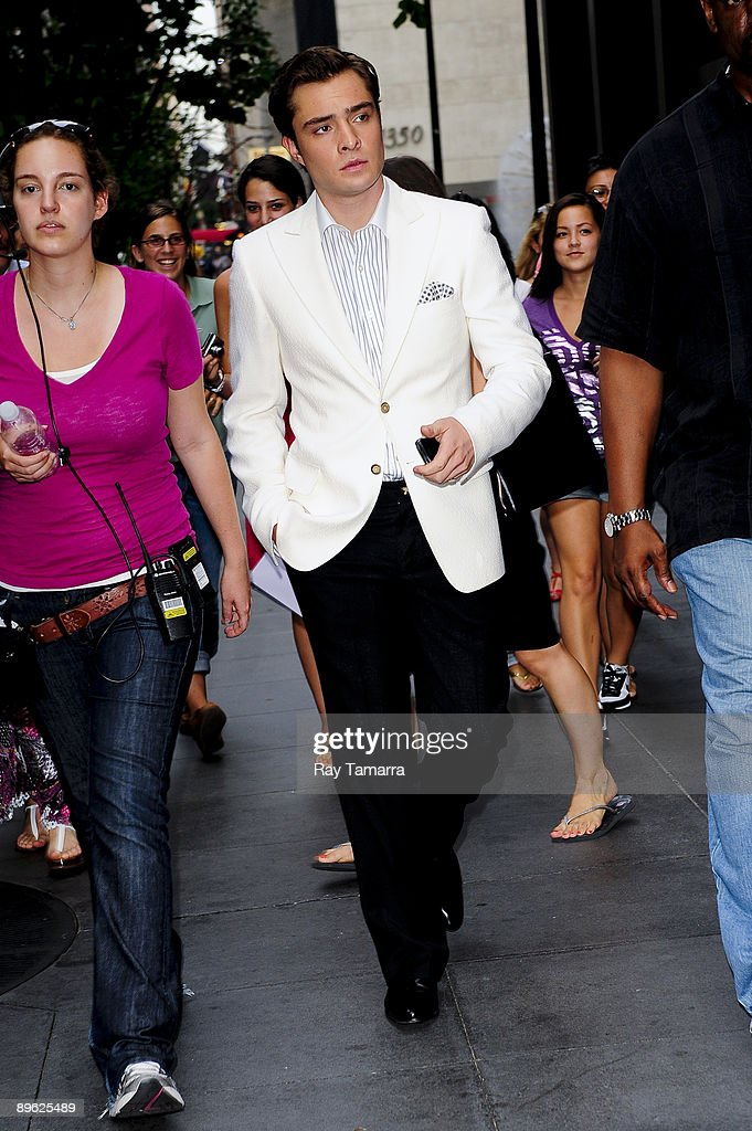 Actor Ed Westwick walks to the 'Gossip Girl' movie set at the Ziegfeld Theater on August 05, 2009 in New York City.