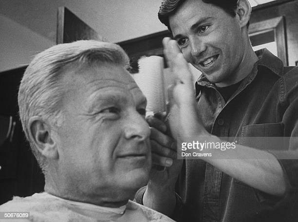 Actor Eddie Albert, having his hair done by Chic barber Jay Sebring .