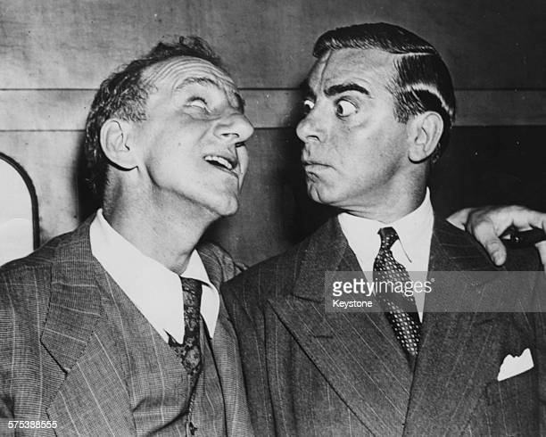 Actor Eddie Cantor mugging at another actor as they joke around July 9th 1938