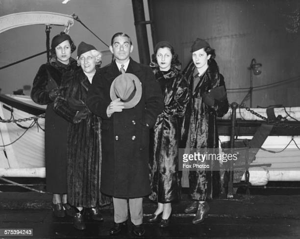 Actor Eddie Cantor on the deck of a ship as he arrives with four women family members in Britain January 1935
