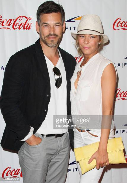 Actor Eddie Cibrian and his wife Recording artist LeAnn Rimes attend the Signature LA Fitness grand opening on June 2 2012 in Woodland Hills...