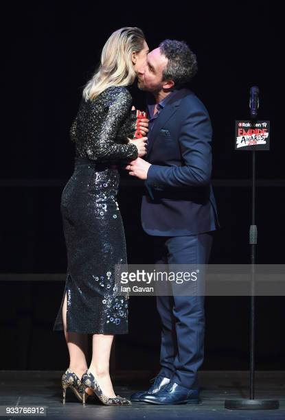 Actor Eddie Marsan presents actress Vanessa Kirby with the award for Best TV Series for 'The Crown' on stage during the Rakuten TV EMPIRE Awards 2018...