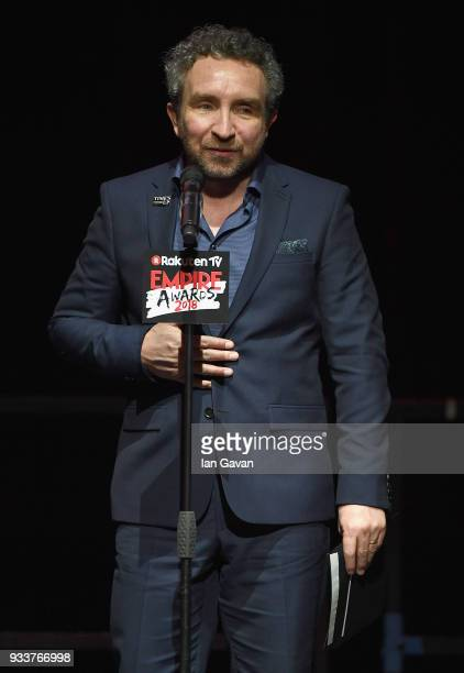 Actor Eddie Marsan presents the award for Best TV Series on stage during the Rakuten TV EMPIRE Awards 2018 at The Roundhouse on March 18 2018 in...