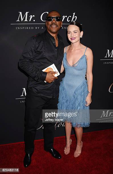 Actor Eddie Murphy and actress Britt Robertson arrive at the premiere of Cinelou Releasing's 'Mr Church' at ArcLight Hollywood on September 6 2016 in...