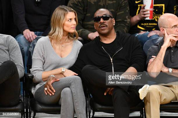 Actor Eddie Murphy and actress Paige Butcher attend a basketball game between the Los Angeles Lakers and the Utah Jazz at Staples Center on April 8...