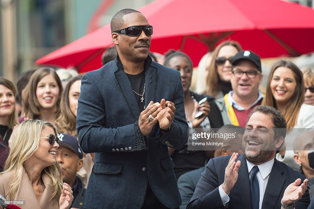Actor Eddie Murphy (L) and director Brett Ratner attend 'Brett Ratner honored with star on the on the Hollywood Walk of Fame' on January 19, 2017 in Hollywood, California.