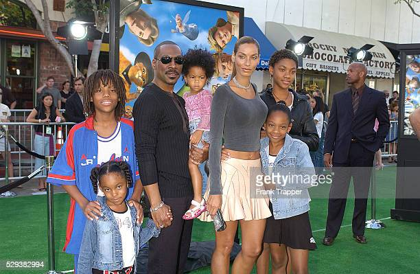 Actor Eddie Murphy and his wife Nicole arrive with their children at the premiere of the computeranimated comedy Shrek 2