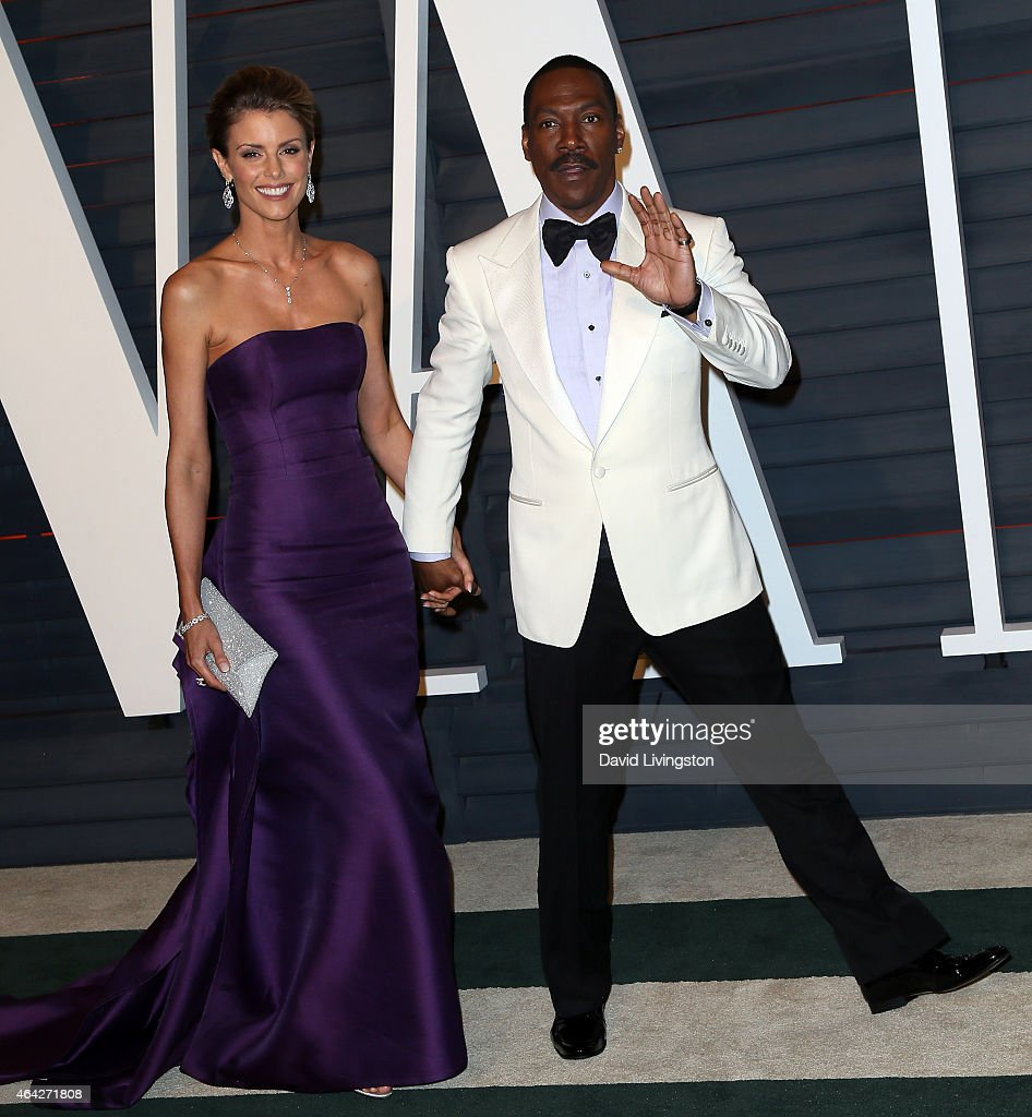 Actor Eddie Murphy (R) and model Paige Butcher attend the 2015 Vanity Fair Oscar Party hosted by Graydon Carter at the Wallis Annenberg Center for the Performing Arts on February 22, 2015 in Beverly Hills, California.