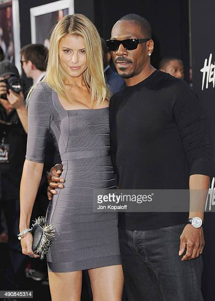 Actor Eddie Murphy and Paige Butcher arrive at the Los Angeles Premiere Hercules at TCL Chinese Theatre on July 23 2014 in Hollywood California