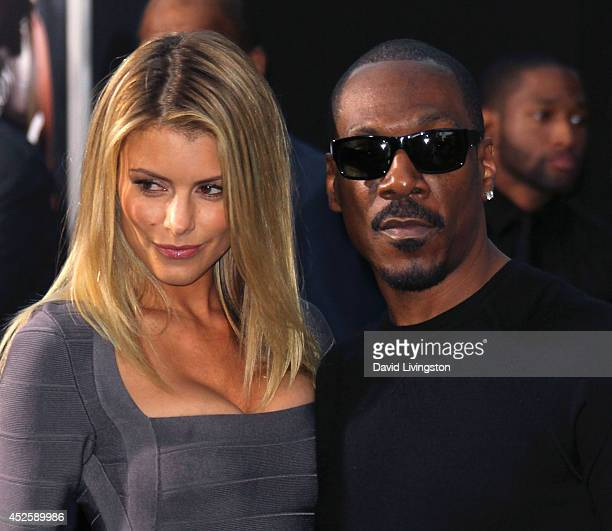 Actor Eddie Murphy and Paige Butcher attend the premiere of Paramount Pictures' Hercules at the TCL Chinese Theatre on July 23 2014 in Hollywood...