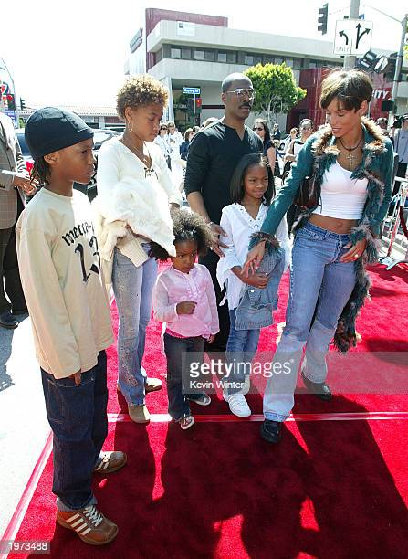 Actor Eddie Murphy his wife Nicole and their children arrive at the premiere afterparty for Daddy Day Care on May 4 2003 in Los Angeles California