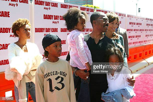 Actor Eddie Murphy his wife Nicole and their children arrive at the premiere of Daddy Day Care at the National Theater on May 4 2003 in Los Angeles...