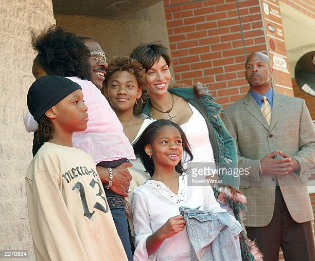 """Actor Eddie Murphy, his wife Nicole and their children arrive at the premiere of """"Daddy Day Care"""" at the National Theater on May 4, 2003 in Los..."""