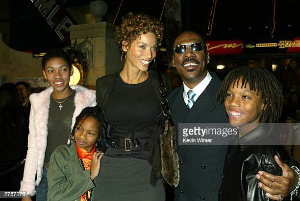 """Actor Eddie Murphy, his wife Nicole and their children Brea , Shane and Miles, 11 arrive at the premiere of """"The Haunted Mansion"""" held on November..."""