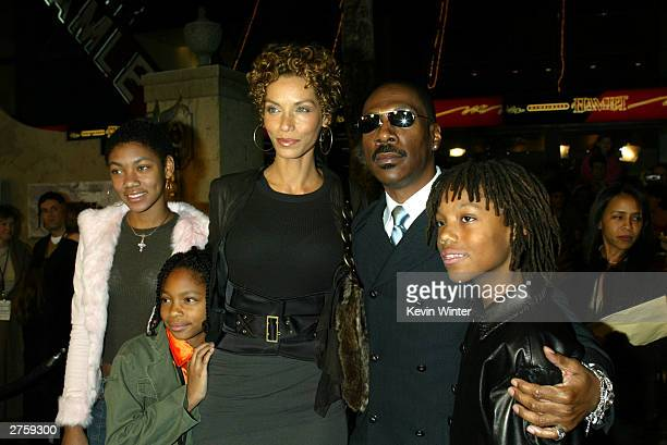 """Actor Eddie Murphy, his wife Nicole and their children Brea , Shane and Miles, 11 arrive at the premiere of """"The Haunted Mansion"""" at the El Capitan..."""