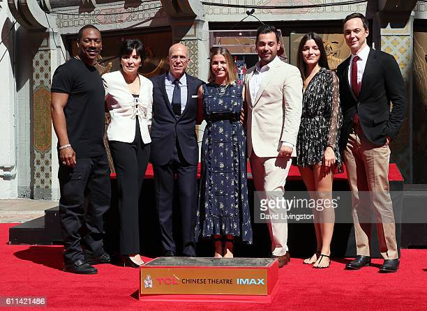 Actor Eddie Murphy Marilyn Katzenberg producer Jeffrey Katzenberg family members and actor Jim Parsons attend the Jeffrey Katzenberg Hand and...