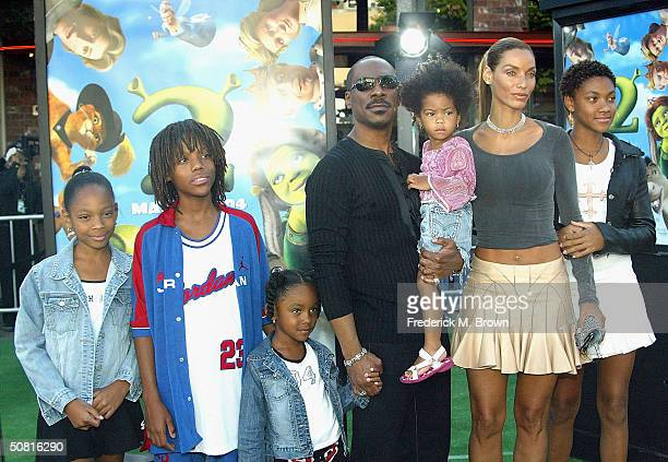 """Actor Eddie Murphy, wife Nicole and children attend the Los Angeles premiere of the Dreamworks Pictures' film """"Shrek 2"""" at the Mann Village Theatre..."""