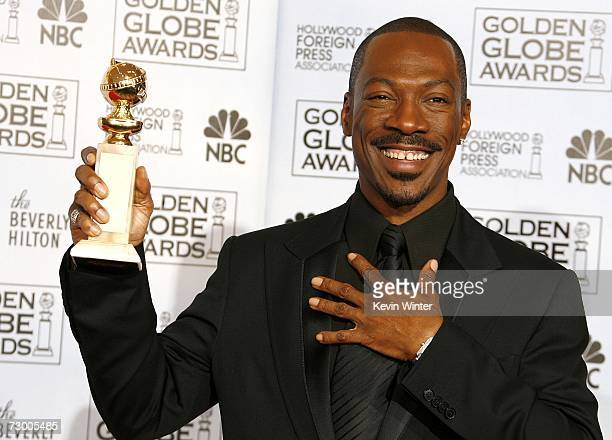 "Actor Eddie Murphy with his Best Performance by an Actor in a Supporting Role in a Motion Picture award for ""Dreamgirls"" poses backstage during the..."