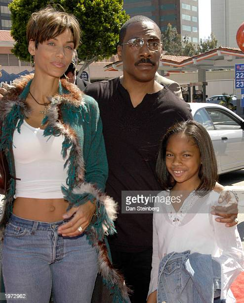 Actor Eddie Murphy with his wife Nicole Mitchell and daughter Shayne arrive at the premiere of the feature film Daddy Day Care on May 4 2003 in Los...