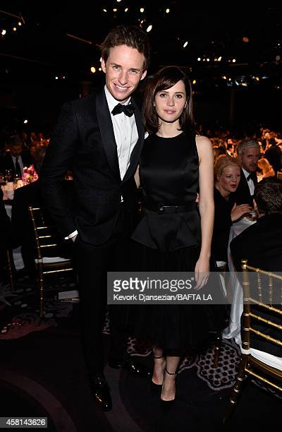 Actor Eddie Redmayne and actress Felicity Jones attend the BAFTA Los Angeles Jaguar Britannia Awards presented by BBC America and United Airlines at...