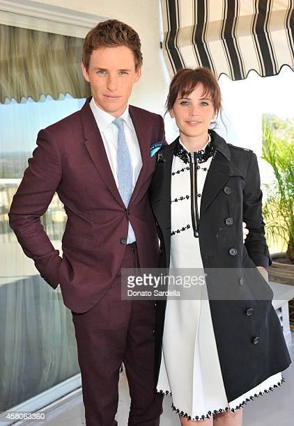 Actor Eddie Redmayne and actress Felicity Jones wearing Burberry at Eddie Redmayne Vanity Fair And Burberry Celebrate BAFTA Los Angeles and the...