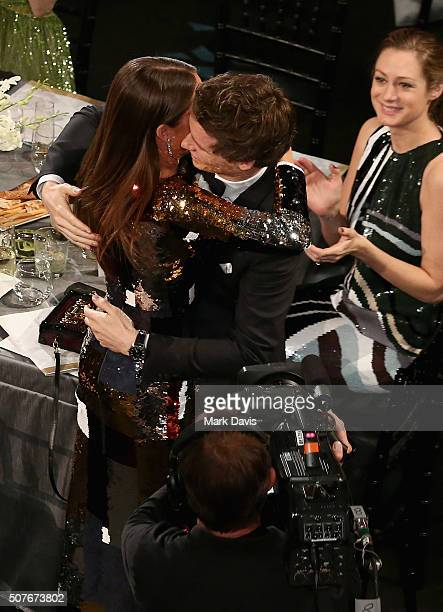 Actor Eddie Redmayne congratulates Alicia Vikander after she won the award for Outstanding Performance by a Female Actor in a Supporting Role during...