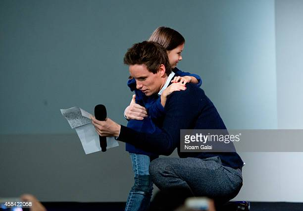 Actor Eddie Redmayne gets a gift from a fan during 'Meet the Actor' at Apple Store Soho on November 4 2014 in New York City